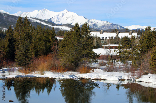 Scenic Colorado nature background with valley and mountains. Beautiful Keystone landscape with snowy rocky mountains, and buildings with accommodations for vacation rental.Ski resort vacation concept.