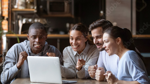 Cuadros en Lienzo  Excited diverse friends cheering watching match on laptop online