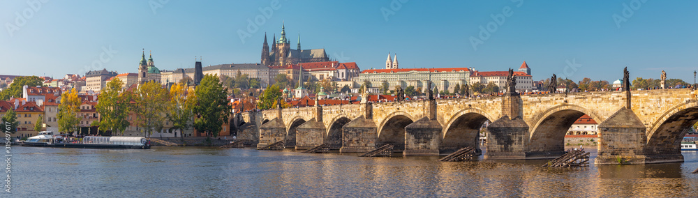 Fototapeta Prague - The panorama of Charles Bridge, Castle and Cathedral withe the Vltava river.