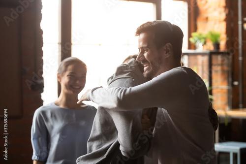 Fotografía Smiling diverse friends hug greeting meeting in bar