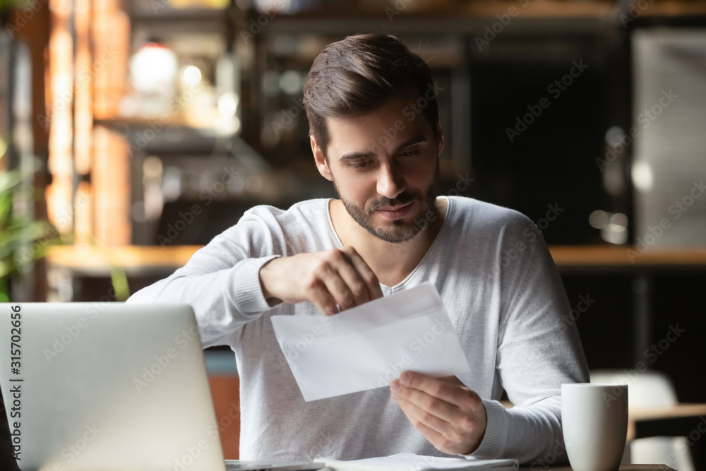 Fototapeta Male student open postal letter from college committee