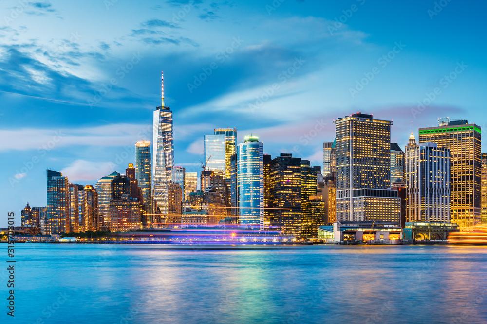 Fototapeta New York, New York, USA downtown city skyline at dusk on the harbor.