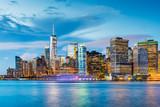 Fototapeta Nowy Jork - New York, New York, USA downtown city skyline at dusk on the harbor.