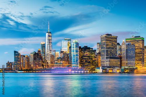 new-york-new-york-usa-downtown-city-skyline-at-dusk-on-the-harbor