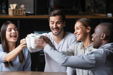 Happy Diverse Friends Say Cheers Having Fun In Cafe Together