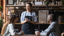 Smiling Waitress Taking Order ...