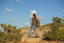 Redheaded Young Woman On A Hiking Trip, Ibiza, Spain