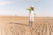 Young Woman Sowing Field For T...