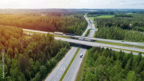 Aerial view of the road with bridge and forest in summer sunny day Wallpaper Mural