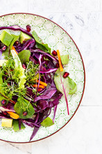 Salad With Red Cabbage, Carrots, Lettuce Leaves, Avocado, Pomegranate Seeds And Cress