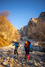Two Hikers Beginning The Ascen...