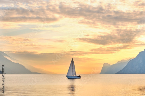 Canvas Print Italy, Trentino, Nago-Torbole, Sailboat sailing near coastal cliffs of Lake Gard