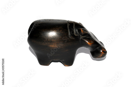 Obraz na plátne A Small Wooden Hippopotamus Hippo Decoration on a White Background