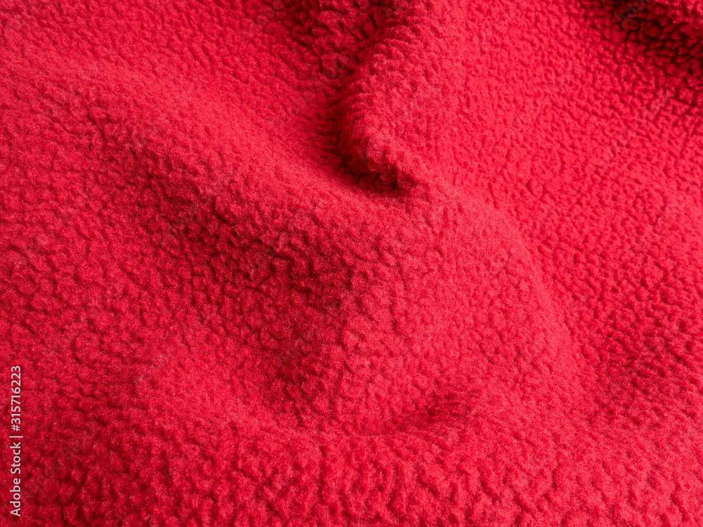 Fototapeta Crumpled warm red polar fleece fabric closeup