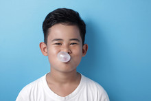 Cute Asian Boy Eating Bubble G...