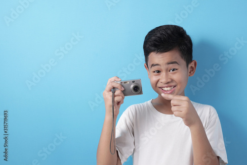 Happy Asian boy doing photography Canvas Print