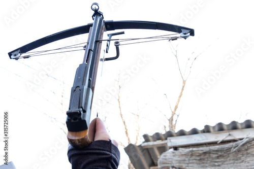 Canvas Print Crossbow in the hands