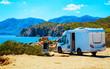 canvas print picture - Camper on road at Capo Pecora at Mediterranean sea in Sardinia Island, Italy summer. Caravan motorhome on holidays at highway. Minivan rv on motorway. Cagliari. Mixed media.