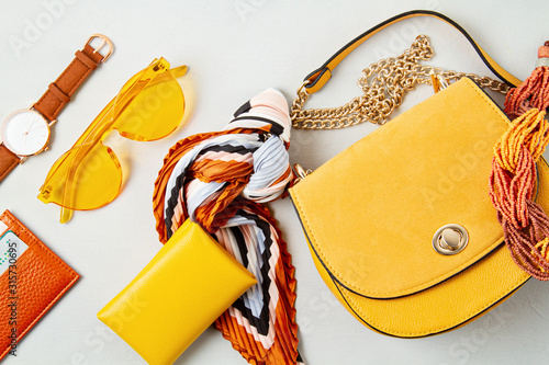 Fototapeta Flat lay with woman fashion accessories in yellow colors. Fashion blog, summer style, shopping and trends idea obraz