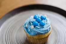 Vanilla Cupcake With Blue Icin...