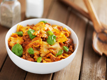 Bowtie Pasta In Tomato Sauce With Basil On Wooden Table