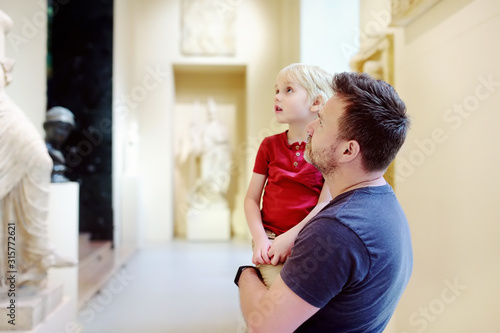 Little boy with his father looking at sculptures. Fototapeta
