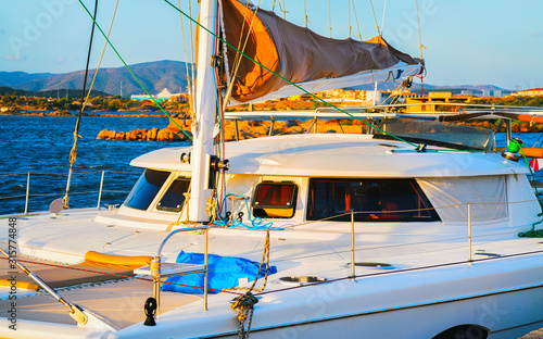 Photo  Harbor with Luxury ship at Mediterranean Sea in Old city of Olbia on Sardinia Island in Italy