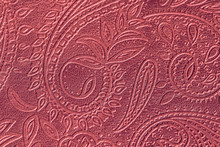 Texture Of Genuine Leather Close-up, Red Color With Embossed Floral Trend Pattern, For Wallpaper, Banner Design. Fashionable Modern Background