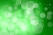 Leinwandbild Motiv Defocused lights over green background