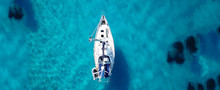 Aerial Drone Ultra Wide Photo Of Sailing Yacht Docked In Paradise Turquoise Sea Exotic Island Destination
