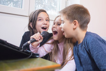 Children Singing Karaoke Toget...