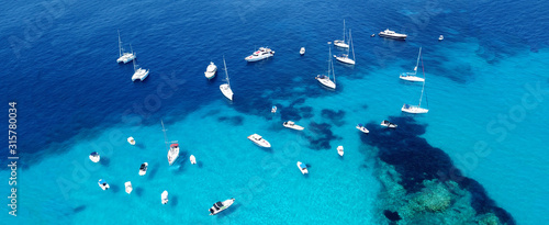 Aerial drone ultra wide photo of sailing yacht docked in paradise turquoise sea Canvas Print