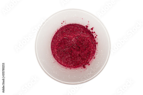 Beets ground in a blender.The texture of mashed beets.Background of grated beetroot.