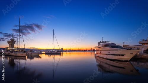 Fotografie, Tablou Yacht port and beautiful sunset over Varna, Bulgaria