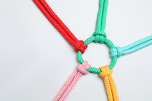Colorful Ropes Tied Together On White Background, Top View. Unity Concept
