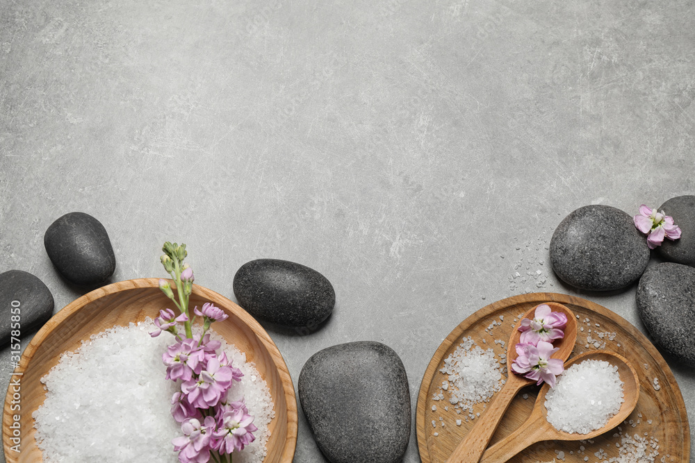 Fototapeta Flat lay composition with sea salt and spa stones on grey marble table. Space for text