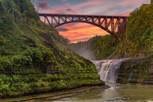 Sunset Over The Upper Falls And Arch Bridge At Letchworth State Park