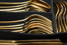 Gold Colored Cutlery In Black ...