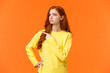 canvas print picture - Jealous or envy sad sulking redhead girl in yellow sweater looking at desired thing, shoppaholic cant buy, dont have money, pointing and staring upper left corner with moody unhappy face