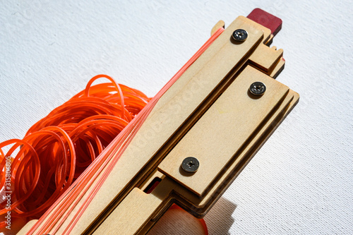taunt rubber bands on a toy gun