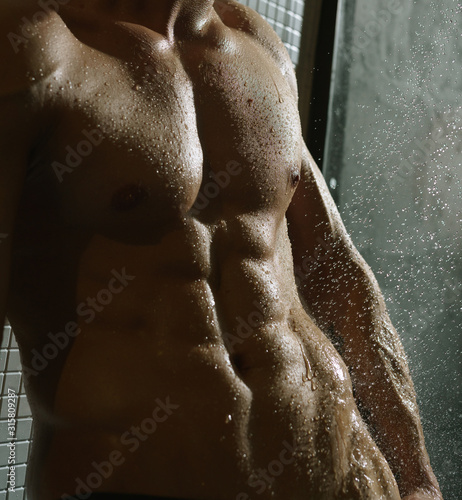 Fotografie, Tablou Nude man taking shower studio portrait