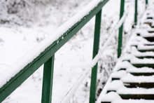 Green Stairs Covered With Snow...