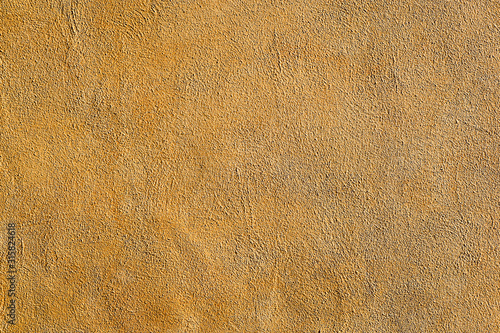 Fotografija Background from a wall of ocre plaster