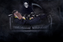 Man Laying Asleep On A Couch With A Book And Being Haunted By A Ghost Like A Nightmare Or A Bad Dream.  Depicts Reading Horror Stories.