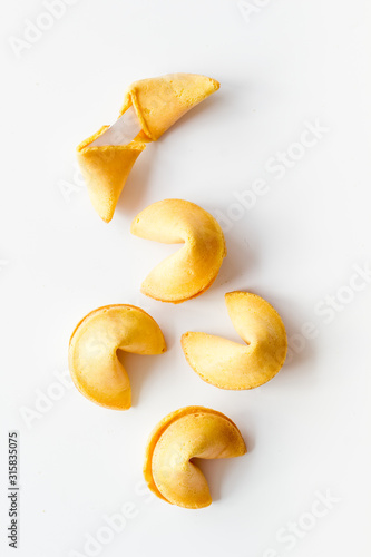 Cuadros en Lienzo Traditional fortune cookies on white table top-down