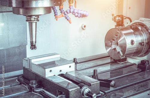 Fototapeta High precision CNC machining center working, operator machining automotive sample part process in industrial factory obraz