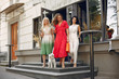 Women shopping. Three elegant woman in a city. Ladies in a stylish dress. Women with a little dog