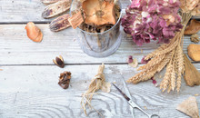 Potpourri  In A Glass Jar And Dry Flowers On A White Wooden Table