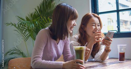 Fototapeta Asian Woman Chatting In Restaurant