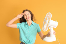 Young Woman With Electric Fan ...